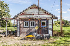 Old garage. With warning sign and snowmobile Royalty Free Stock Image