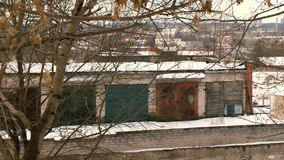 Old garages under the trees. Old soviet style garages under the trees in winter stock footage