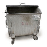 Old garbage container. An old metal garbage container isolated on white Stock Images