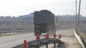 An old garbage truck drives along the road. Container stock video