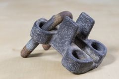 Old garden accessories. Rusty hose clamps on the workshop table. Light background stock image