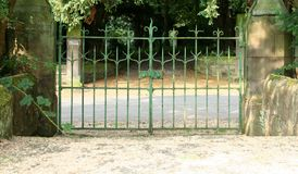 Old garden gates. Beautiful green rusty garden gates Royalty Free Stock Images