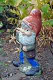 Old garden gnome Stock Images
