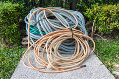 Old Garden Hose. For watering garden. Rolled up together royalty free stock image