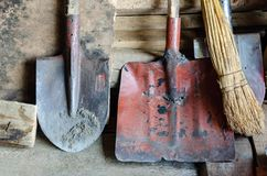 Old garden shovels over wall royalty free stock images
