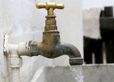 Old garden tap with plastic hose connection Royalty Free Stock Image