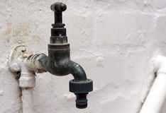 Old garden tap with plastic hose connection Royalty Free Stock Images