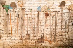 Old garden tools. Hanging on the wall Royalty Free Stock Image