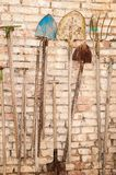 Old garden tools. Hanging on the wall stock photo