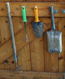 Old garden tools hanging on a wooden wall, South Bohemia Royalty Free Stock Image