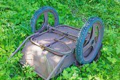 Old garden wheelbarrow Stock Images