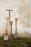 Old gardening tools. At a wall Stock Images