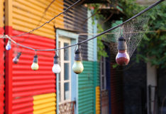 Old garland of bulbs in a web.Caminito Street. Stock Image