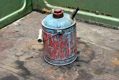 Old gas can. Old gas can on the back of a pickup truck stock photos
