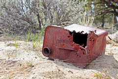 Old Gas Can Laying In Sand Stock Photography