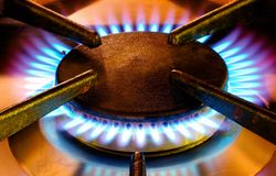 Old gas cooker hob in operation Stock Photo