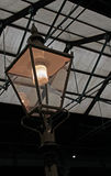 An old Gas Lamp. A group of old wooden fish boxes Stock Image