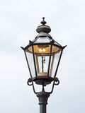 Old gas lantern. Is lit during the day Stock Images