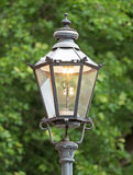Old gas lantern. Is lit during the day Stock Photography