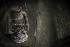 Old gas lantern on wood Royalty Free Stock Image
