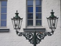 Old gas lanterns in Kaiserswerth Germany well maintained and still used. A high window royalty free stock image