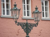 Old gas lanterns well maintained and still used ,in front of a red house. Jugendstil stock photo