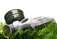 Old gas mask on the Grass Stock Image