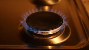 Old gas oven. An old rusty gas oven with soft light, turning on and off stock footage
