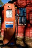 Old Gas Pump. An old gas pump in front of an abandoned country store Stock Images