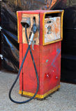 Old gas pump. An old retro red gasoline pump with a black hose Stock Images