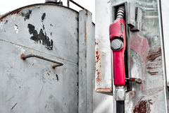 Old gas pump metal rusty station in yard Royalty Free Stock Image