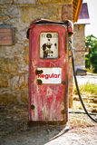 Old gas pump. View of a red old broken gas pump stock images