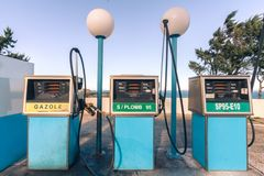 Old gas station in France. 80`s vintage style stock photo
