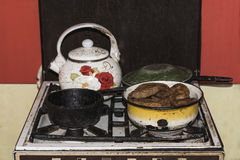In the old gas stove is a pot of pies and other dishes, vintage effect. Ukraine stock photos