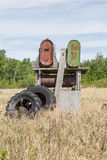 Old gas tanks. Old rusty gas tanks with a set of tractor tires Stock Photography