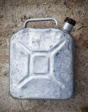 Old gasoline jerry can above concrete background Stock Photos