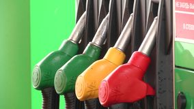 Old gasoline or petrol station gas fuel pump nozzle. Filling or petrol station. stock video footage