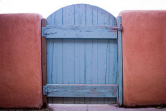 Old gate. With peeling blue paint Royalty Free Stock Images