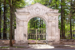 Old gate arch of military unit of Soviet Army Stock Photos