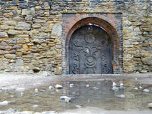 Old gate around the Saxon Tower and church in central area Media. S, Romania, with nice atmosphere and rocks and water in front of it Royalty Free Stock Photography