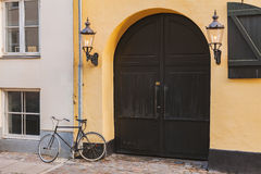 Old gate and bike. Image of old wooden gate with bycycle in front. Copenhagen, Denmark Royalty Free Stock Photography