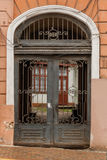 An old gate with a corridor leading to the courtyard of the hous Royalty Free Stock Photography