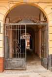 An old gate with a corridor leading to the courtyard of the hous Stock Photo