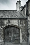 Old gate with door in Oxford Stock Photography