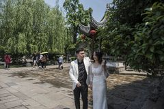 Young couple taking wedding photos in scenic area. The Old Gate East area of Nanjing Qinhuai District of Nanjing has the characteristics of Nanjing Old Town stock photos