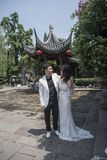Young couple taking wedding photos in scenic area. The Old Gate East area of Nanjing Qinhuai District of Nanjing has the characteristics of Nanjing Old Town stock photography
