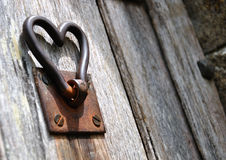 Old gate handle raised to make heart shape Royalty Free Stock Image