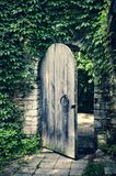 Old Gate In The Medieval Stone Castle Wall Royalty Free Stock Image