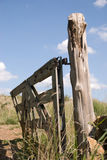 Old gate on knotty post Stock Photography
