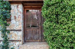 Old gate surrounding by greenery.  Royalty Free Stock Photo